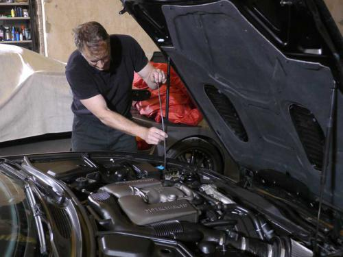 Manor Car Storage Mechanic servicing car in storage
